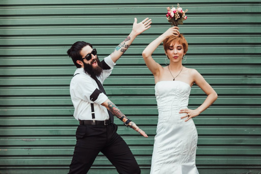 Newlyweds taking pictures with an industrial background