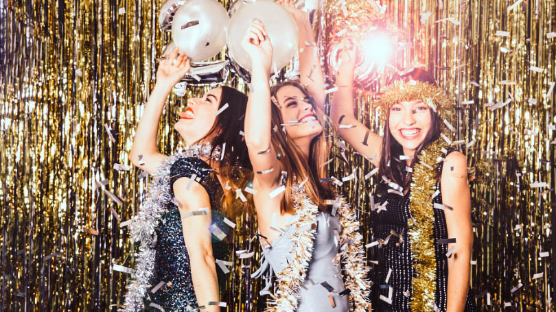 Women partying for new year with a lot of glitters