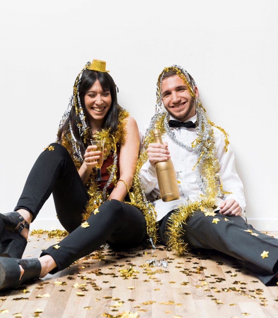 Couple wearing golden props for a New Year picture